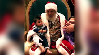 Baby Refuses To Leave Santa Claus - Video