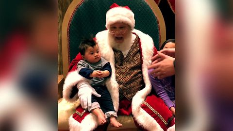 Baby Refuses To Leave Santa Claus