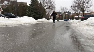 Man Skates on Frozen Toronto Street - Video
