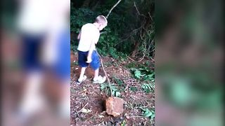 Kid Tries To Chop Slingshot, Gets Slapped In The Face With The Branch - Video