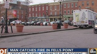 Man catches fire in Fells Point - Video