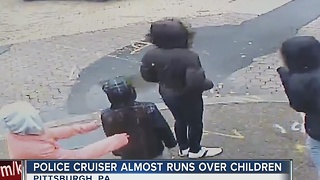 Police car almost slams into children and it's caught on camera - Video