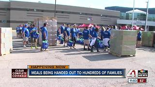 Volunteers hand out meals to hundreds of families - Video