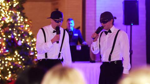 Brothers perform surprise rap toast for bride and groom
