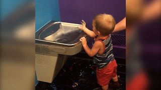 Cute Kid Struggles With Water Fountain