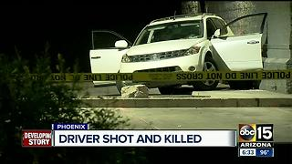 Three detained after body found in SUV in west Phoenix - Video