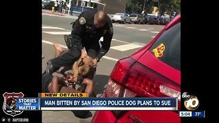 Man bitten by police dog plans to sue - Video