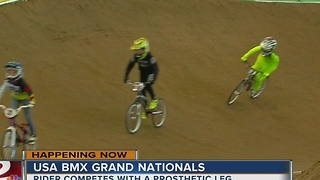 Rider with prosthetic leg competes in BMX Grand Nationals - Video