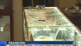 Jewelry store owner attacked during smash and grab - Video