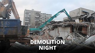 Residents gawk as 100 buildings demolished over night - Video