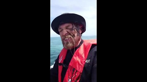 Fisherman gets inked in the face by slippery squid who doesn't want to be caught