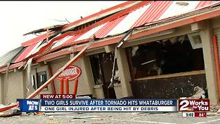Friends cling to each other while tornado rips apart midtown Whataburger - Video