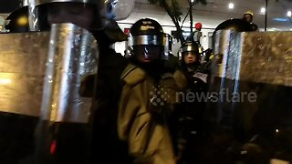 Riot police use pepper spray against protesters in Hong Kong