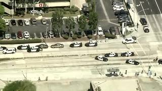 Suspect held, LA-area hospital searched after shooter report