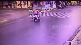 Crazed pedestrian punches girl, 6, in face while she rides moped with father