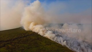 Dramatic aerial views of large gorse fire still raging in Northern Ireland - Video