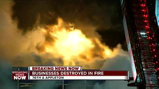 Milwaukee fire crews fight blaze at north side store front - Video