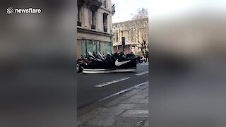 Man spotted driving unique giant Nike shoe around Paris