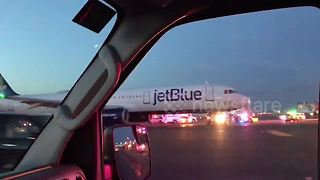 SWAT team storms JetBlue plane at JFK airport after pilot accidentally reports hijacking