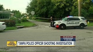 Tampa police investigators on scene of officer involved shooting - Video