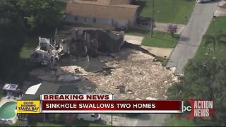 Pasco sinkhole stabilizes after gobbling up 2 houses, threatening 9 more - Video