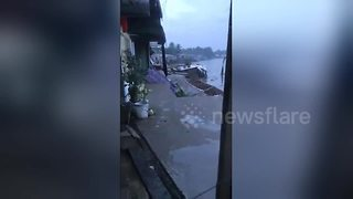 Terrifying moment houses swept away into river by landslides - Video