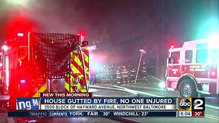 Three safely escape from massive Baltimore house fire - Video