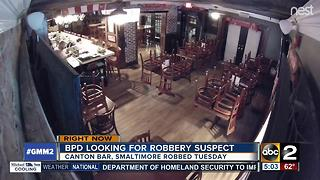 Police search for Smaltimore bar robbery suspect - Video