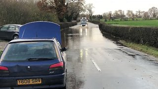 Vehicles Drive Through Flooded Roads in Lancashire - Video