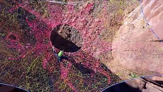A Talented Group Of Base Jumpers Show Their Skills On A Spider Web Slackline