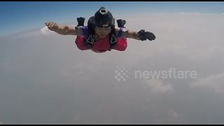 Indian woman skydives wearing 27-feet traditional saree - Video