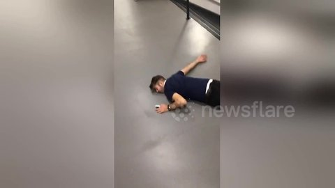 Knackered man takes a tumble down the stairs after heavy night out