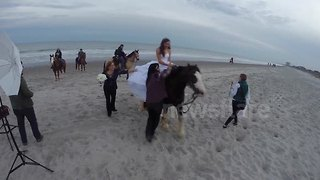 Bride thrown from horse during photo shoot - Video