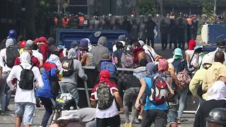 Clashes on the streets of Caracas as Venezuela stages mass protests