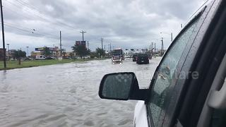 Footage captures cars driving through flooded streets of McAllen, Texas