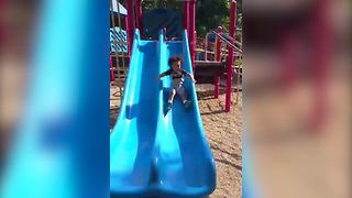 Little Boy's Hilarious Adventures On A Slide - Video