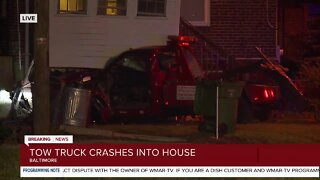 One person seriously injured after a tow truck crashes into a home