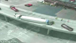Semi rollover causes traffic headaches in Lake Interchange - Video