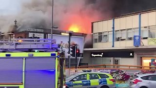 Firefighters Battle Blaze at Poundland in Chingford - Video