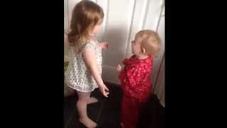 Baby siblings argue about laundry room dryer - Video