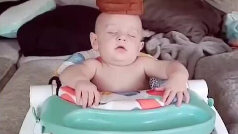 Parents stack food on top of sleeping baby's head