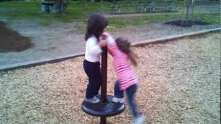 Children Spin at the Playground - Video