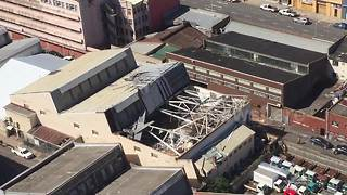 Roof torn off large industrial building - Video