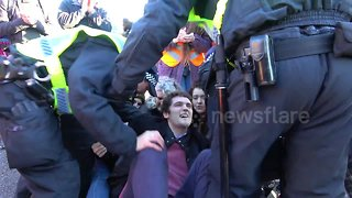 Dozens of arrests as London bridges blocked by thousands of climate change protesters