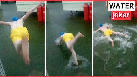 Holidaymaker jumping into floodwater