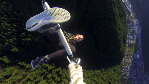 Professional Aerialist Performs Stunts Hanging From Paraglider At 3000 Feet