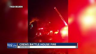 Crews battle Oshkosh fire in multi-unit home - Video
