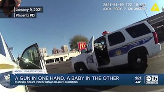 Phoenix police release video of a man shot while holding a baby