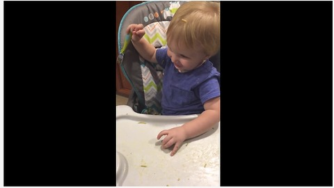 Baby throws food on dog's back, dog can't reach it