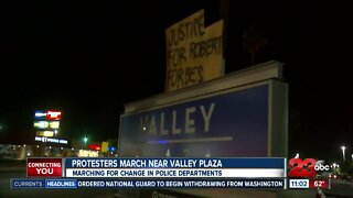 Protestors march near valley plaza for change in police departments